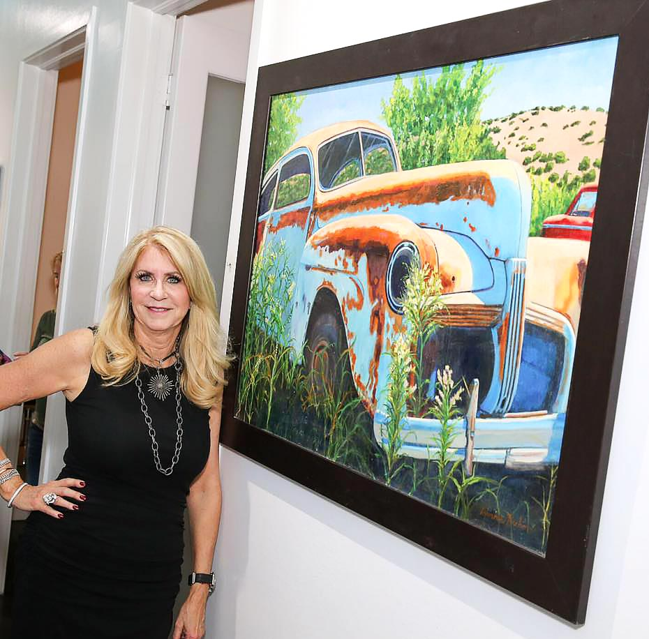 south florida artist bonnie perlin with her painting titled abandoned